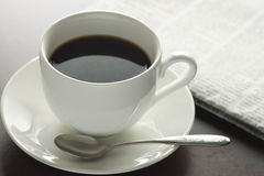 A Cup of hot coffee on the table Stock Image