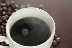 A Cup of hot coffee on the table Stock Photography