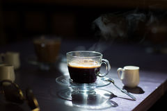 Cup of hot coffee on the table Stock Images