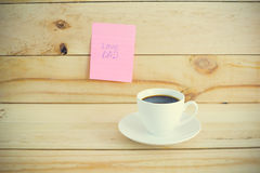 Cup of hot coffee on table. Royalty Free Stock Image