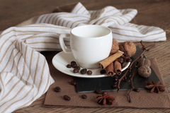 A cup of hot coffee and themed items around it. Stock Photos