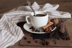 A cup of hot coffee and themed items around it. A cup of hot coffee and themed items around it on a wooden table Royalty Free Stock Photos