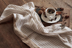 A cup of hot coffee and themed items around it. Stock Photography