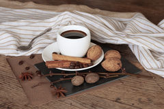 A cup of hot coffee and themed items around it. Royalty Free Stock Photography