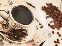 Cup of hot coffee at vintage napkin Stock Image