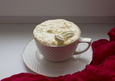 Cup with hot coffee and whipped cream stock photography