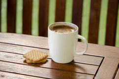 Cup of hot coffee in white cup and cookie biscuit Royalty Free Stock Images