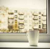 Cup of hot coffee on the window Royalty Free Stock Photos