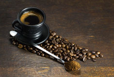 Cup of hot coffee on wooden background. A cup of hot coffee on wooden background stock images