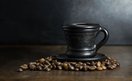 Cup of hot coffee on wooden background. A cup of hot coffee on wooden background royalty free stock photography
