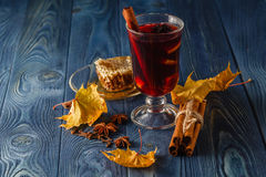 Cup of hot drink and autumn leaves, close up Stock Image
