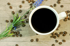 Cup of hot drink with coffee beam and lavender flower on wooden Stock Photo