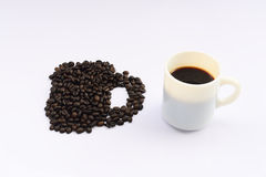 Cup of hot drink with coffee bean Stock Image