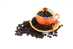 Cup of hot drink with coffee bean Royalty Free Stock Images