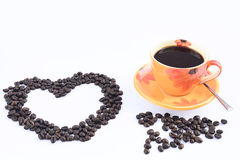 Cup of hot drink with coffee bean and heart Royalty Free Stock Photography