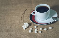 Cup of hot drink with coffee beans Stock Images