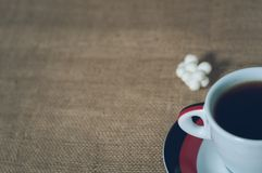 Cup of hot drink with coffee beans Stock Photography