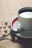 Cup of hot drink with coffee beans Royalty Free Stock Photography