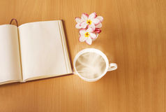 Cup of hot drink or coffee with plumeria or frangipani flowers i Stock Photos