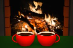 Cup of hot drink in front of warm fireplace. Holiday Christmas concept Royalty Free Stock Photo