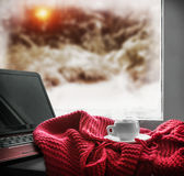 Cup with a hot drink and a laptop Stock Image
