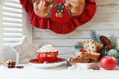 Cup of hot drink with marshmallow and Christmas cupcake. Compos. Ition with Christmas wreath, fur-tree branches and Christmas decorations. Close up on white stock photos