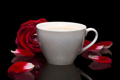 Cup with hot drink, rose Royalty Free Stock Photos