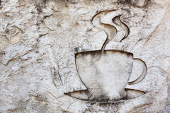 Cup of hot drink sign carving on stone Stock Photo