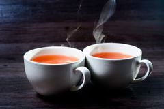 Cup of hot drink with steam. Stock Image