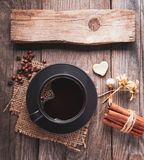 Cup of hot espresso among autumn plants on wooden vintage table,. Coffee on the old board grunge including dried plants, top view stock photography