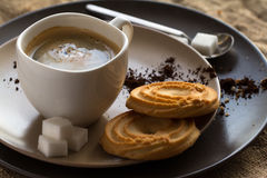 Cup of hot espresso coffee, and cookie Stock Images