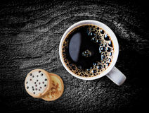 Cup of hot espresso coffee wiith biscuits Stock Photography