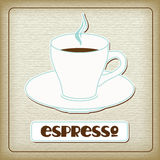 A cup of hot espresso in the old cardboard Royalty Free Stock Photos