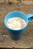 Cup of hot frothy cappuccino coffee Stock Photography