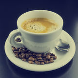 Cup of hot frothy espresso coffee Royalty Free Stock Photos
