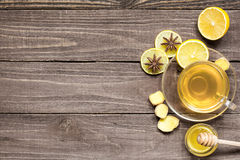 Cup of hot green healthy tea with lemon, honey and spices Stock Photo