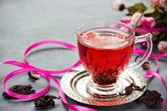 Cup of hot hibiscus tea karkade, red sorrel, rosella Stock Images