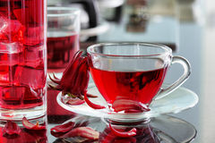 Cup of hot hibiscus tea (rosella, karkade) on kitchen table Royalty Free Stock Photos