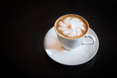 A Cup of hot latte art coffee Royalty Free Stock Images