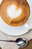 Cup of hot latte art coffee Royalty Free Stock Image