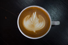 Cup of hot latte art coffee. Royalty Free Stock Image