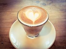Cup of hot latte or cappuccino with fascinating latte art Stock Photography
