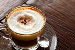 Cup of hot latte coffee in garden. A cup of hot latte coffee in garden Royalty Free Stock Photo