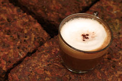 Cup of hot latte coffee in garden. A cup of hot latte coffee in garden Stock Photo