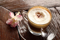Cup of hot latte coffee on wood table. A cup of hot latte coffee on wood table Stock Photo