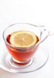 A cup of hot lemon tea with lemon slice Royalty Free Stock Photo