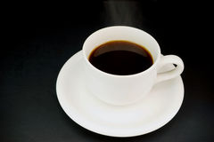 Cup with hot liquid and steam on black Royalty Free Stock Photo