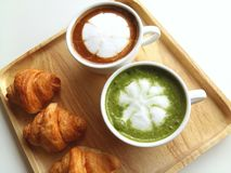 Cup of hot matcha and coffee so delicious on wood. A cup of hot green tea and coffee so delicious on wood Stock Images