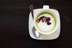 Cup of hot matcha green tea latte Stock Photos