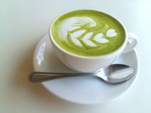 A cup of hot matcha latte so delicious on white. Cup of hot matcha latte so delicious on white Royalty Free Stock Photos